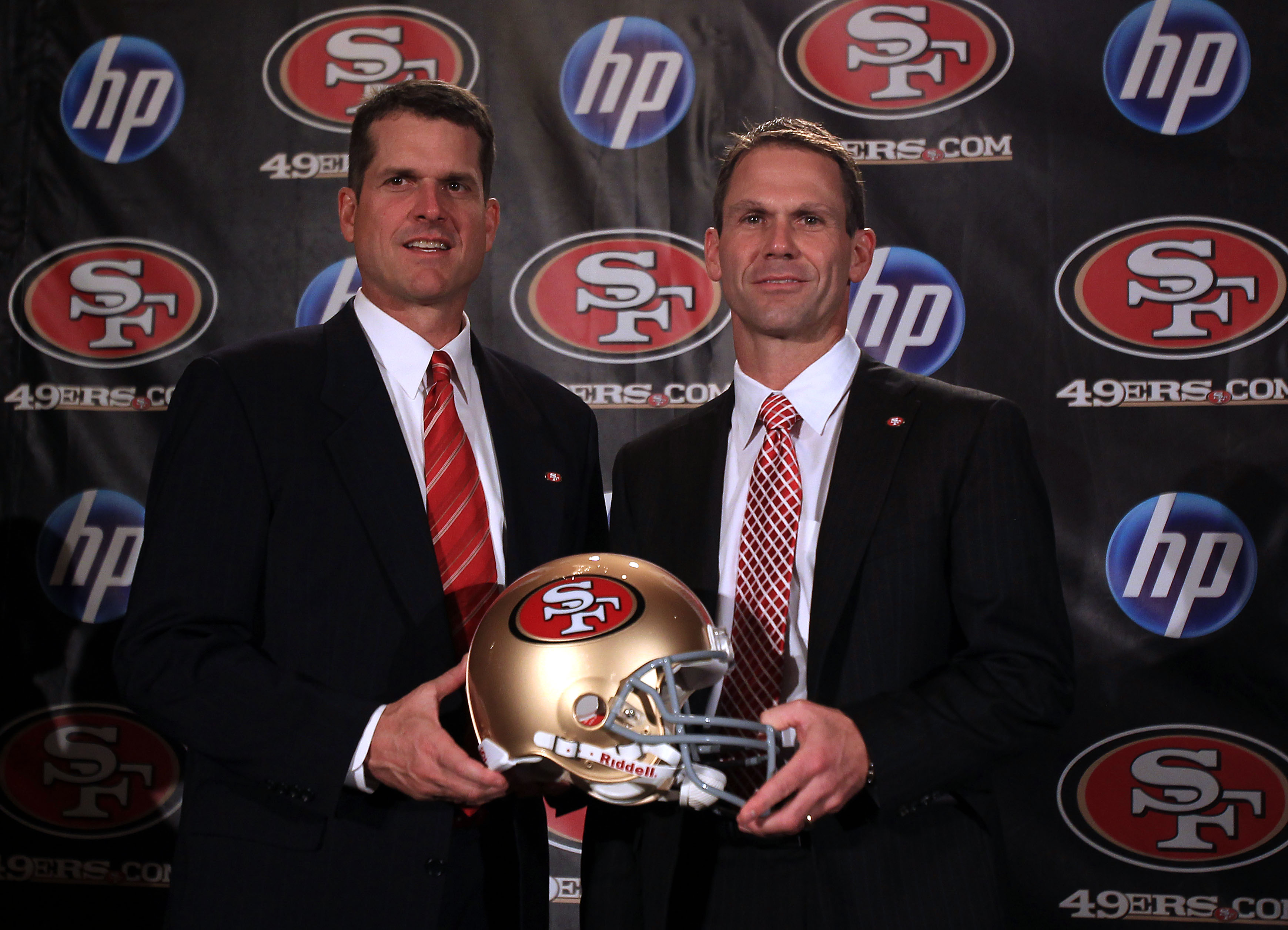 SAN FRANCISCO, CA - JANUARY 07:  Jim Harbaugh and general manager Trent Baalke pose for a picture following a press conference where Harbaugh was introduced as the new San Francisco 49ers head coach at the Palace Hotel on January 7, 2011 in San Francisco,