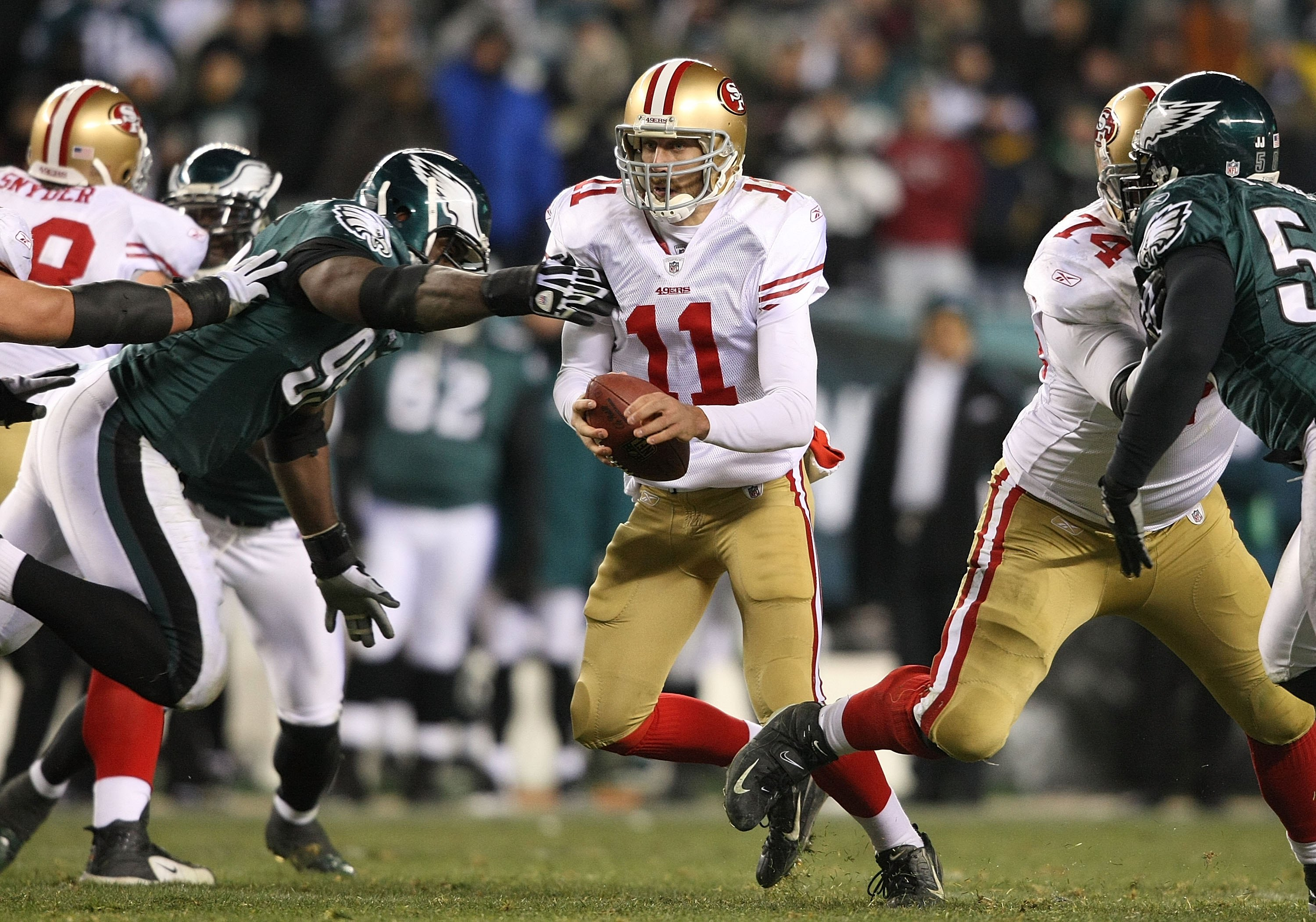 PHILADELPHIA - DECEMBER 20:  Alex Smith #11 of the San Francisco 49ers runs against the Philadelphia Eagles at Lincoln Financial Field on December 20, 2009 in Philadelphia, Pennsylvania.  (Photo by Nick Laham/Getty Images)