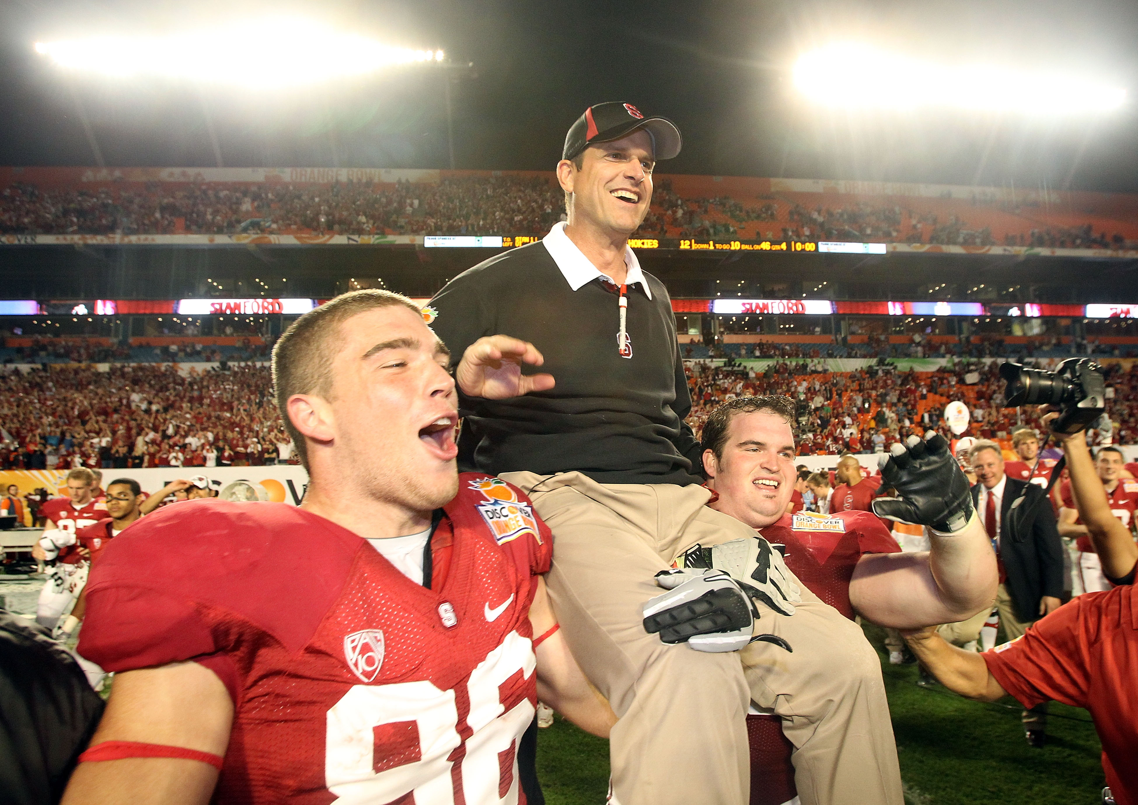 MIAMI, FL - JANUARY 03:  Head coach Jim Harbaugh of the Stanford Cardinal celebrates as he is lifted up by his players including Zach Ertz #86 (L) after Stanford won 40-12 against the Virginai Tech Hokies during the 2011 Discover Orange Bowl at Sun Life S