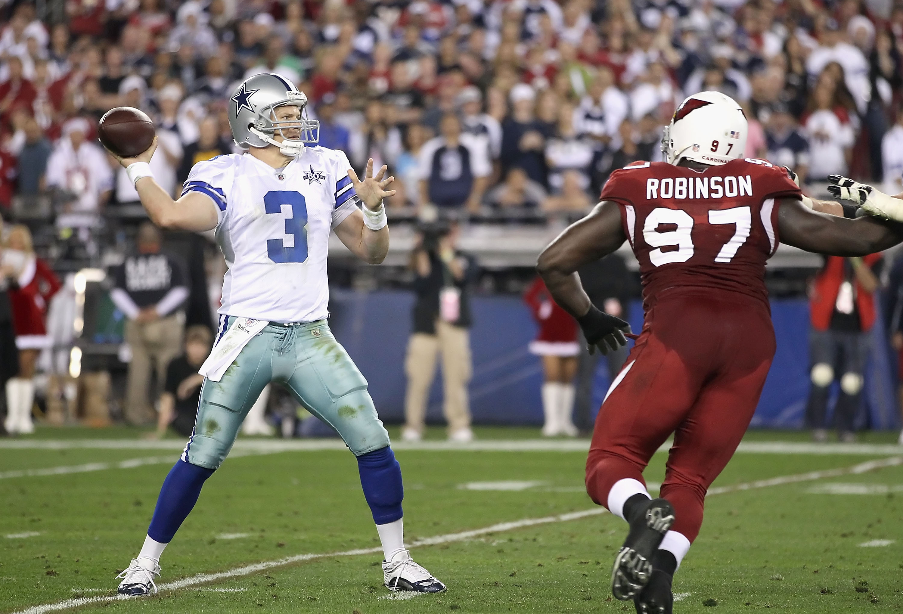 GLENDALE, AZ - DECEMBER 25:  Quarterback Jon Kitna #3 of the Dallas Cowboys throws a pass during the NFL game against the Arizona Cardinals at the University of Phoenix Stadium on December 25, 2010 in Glendale, Arizona. The Cardinals defeated the Cowboys
