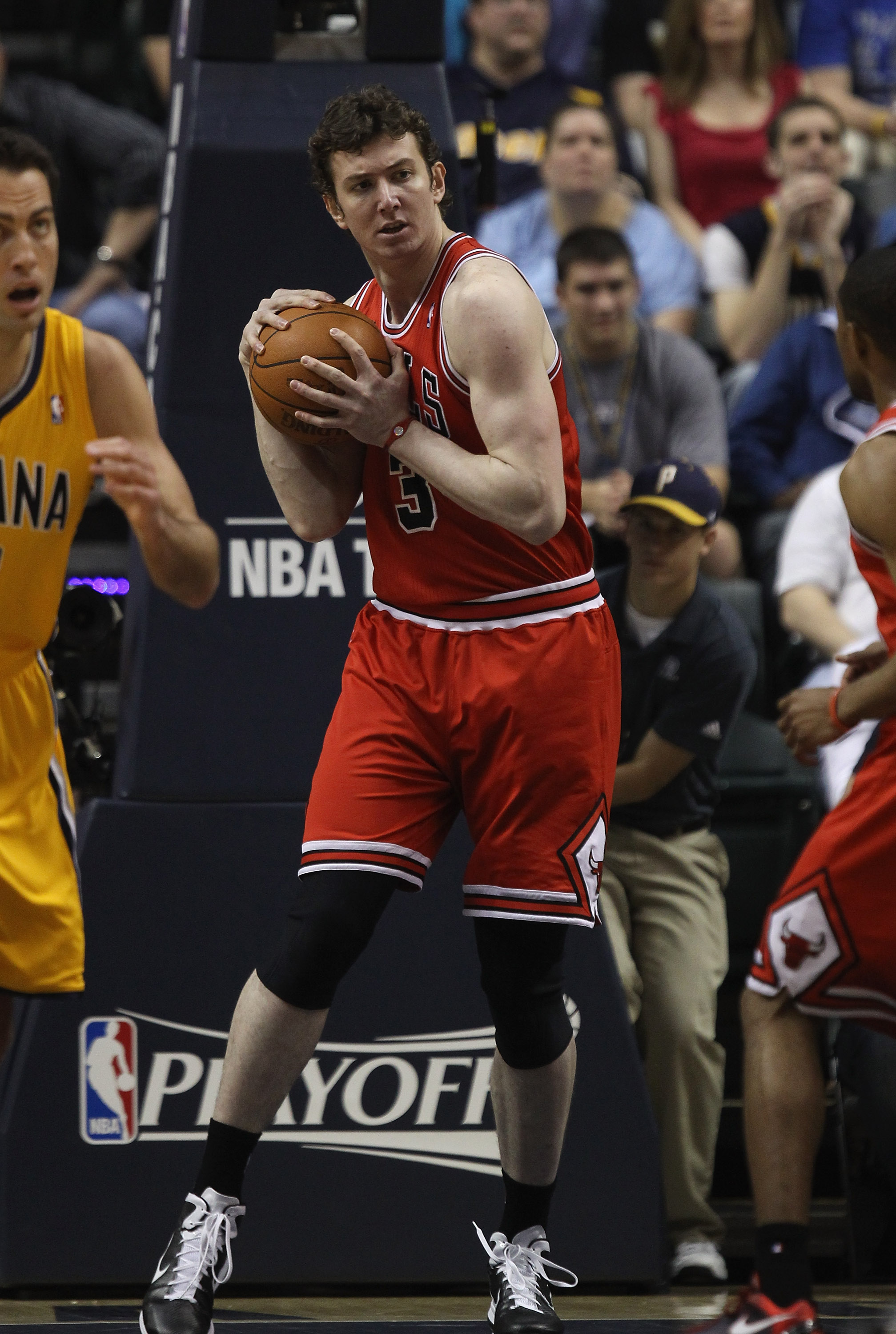 INDIANAPOLIS, IN - APRIL 23: Omer Asik #3 of the Chicago Bulls grabs a rebound against the Indiana Pacers in Game Four of the Eastern Conference Quarterfinals in the 2011 NBA Playoffs at Conseco Fieldhouse on April 23, 2011 in Indianapolis, Indiana. The P
