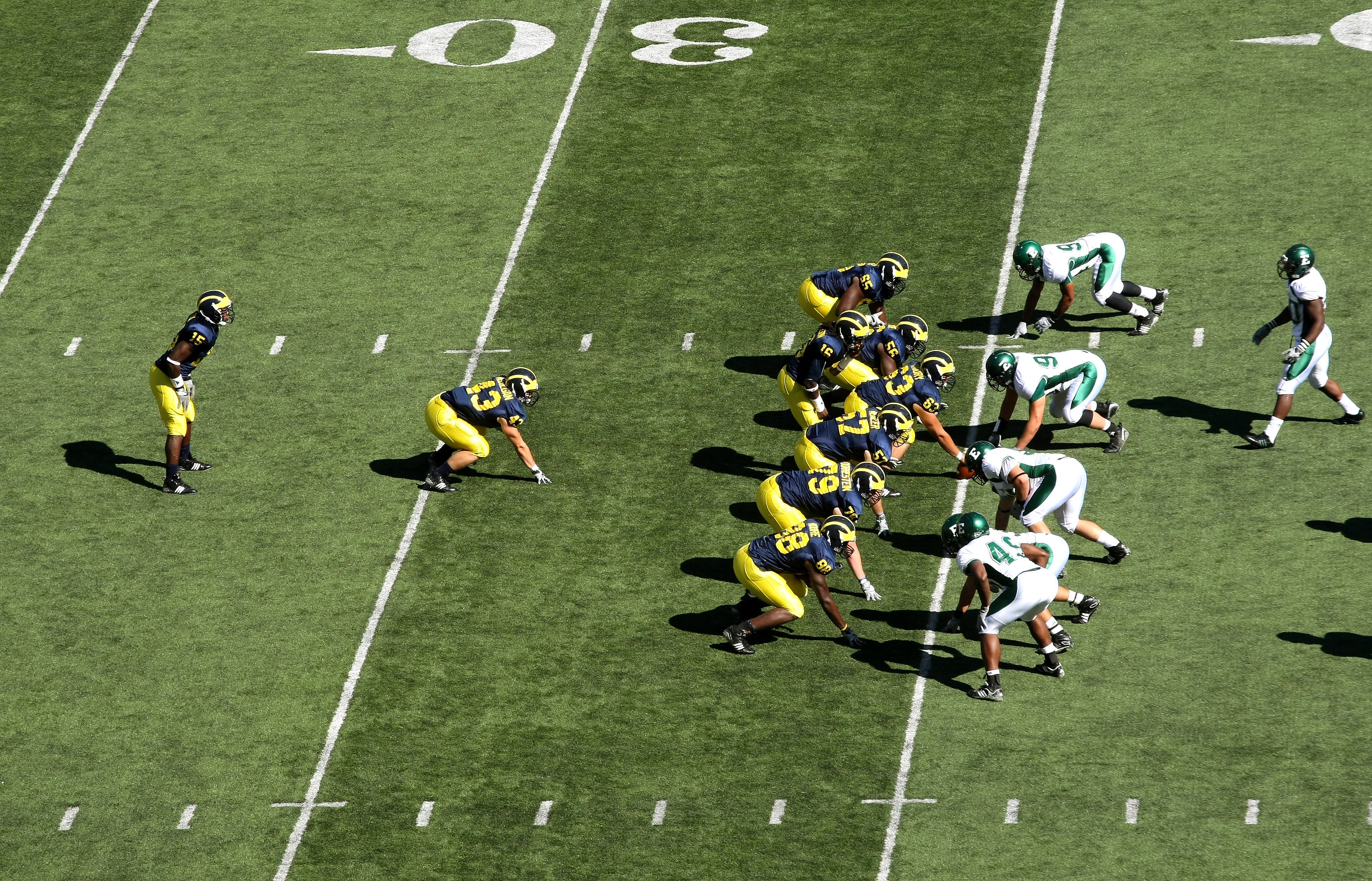 ANN ARBOR, MI - SEPTEMBER 19:  The Michigan Wolverines  offense sets on the line of scrimmage agaisnt the Eastern Michigan Eagles at Michigan Stadium on September 19, 2009 in Ann Arbor, Michigan.  Michigan won 45-17.  (Photo by Stephen Dunn/Getty Images)