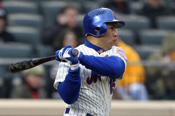 NEW YORK, NY - APRIL 08:  Carlos Beltran #15 of the New York Mets hits a double in the bottom of the sixth inning against the Washington Nationals during the Mets' Home Opener at Citi Field on April 8, 2011 in the Flushing neighborhood of Queens in New Yo