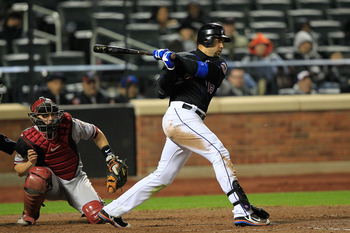 NEW YORK, NY - APRIL 22: Carlos Beltran #15 of the New York Mets hits an RBI in the eighth inning against the Arizona Diamondbacks at Citi Field on April 22, 2011 in the Flushing neighborhood of the Queens borough of New York City.  (Photo by Chris Trotma