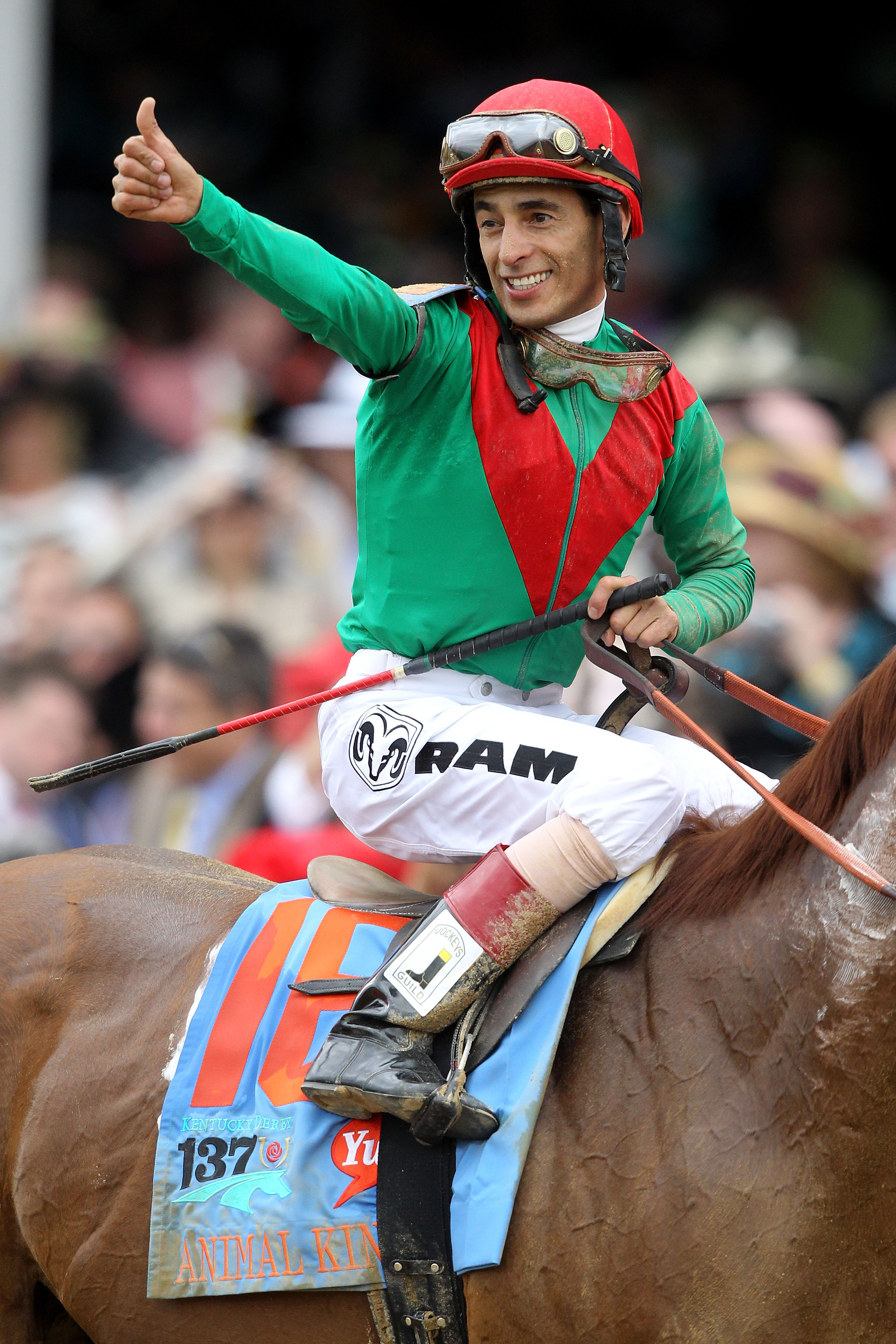 LOUISVILLE, KY - MAY 07:  Jockey John Velazquez, riding Animal Kingdom #16, celebrates winning the 137th Kentucky Derby at Churchill Downs on May 7, 2011 in Louisville, Kentucky.  (Photo by Matthew Stockman/Getty Images)