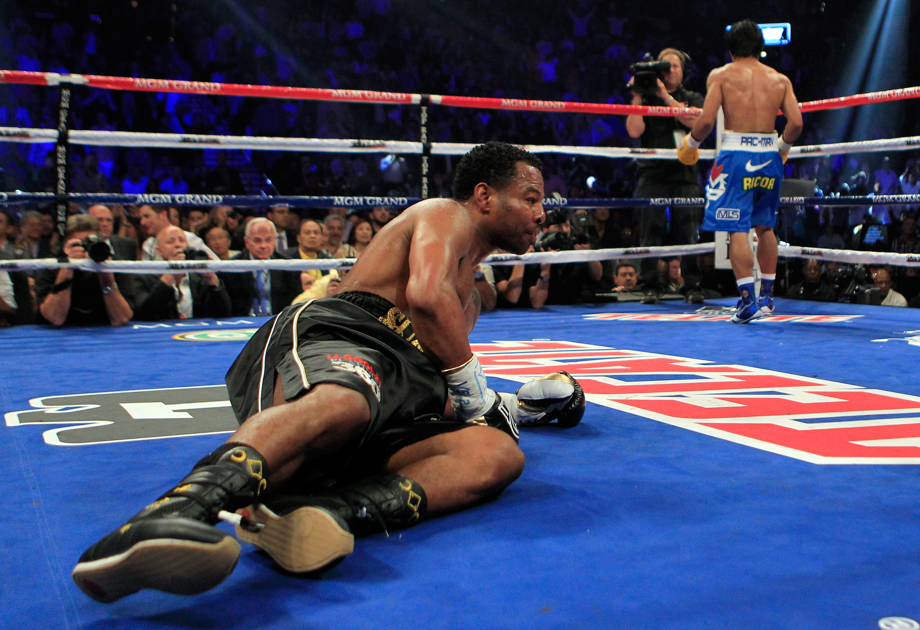 LAS VEGAS, NV - MAY 07:  (L) Shane Mosley is knocked down in the third round by Manny Pacquiao of the Philippines in the WBO welterweight title fight at MGM Grand Garden Arena on May 7, 2011 in Las Vegas, Nevada.  (Photo by Chris Trotman/Getty Images)