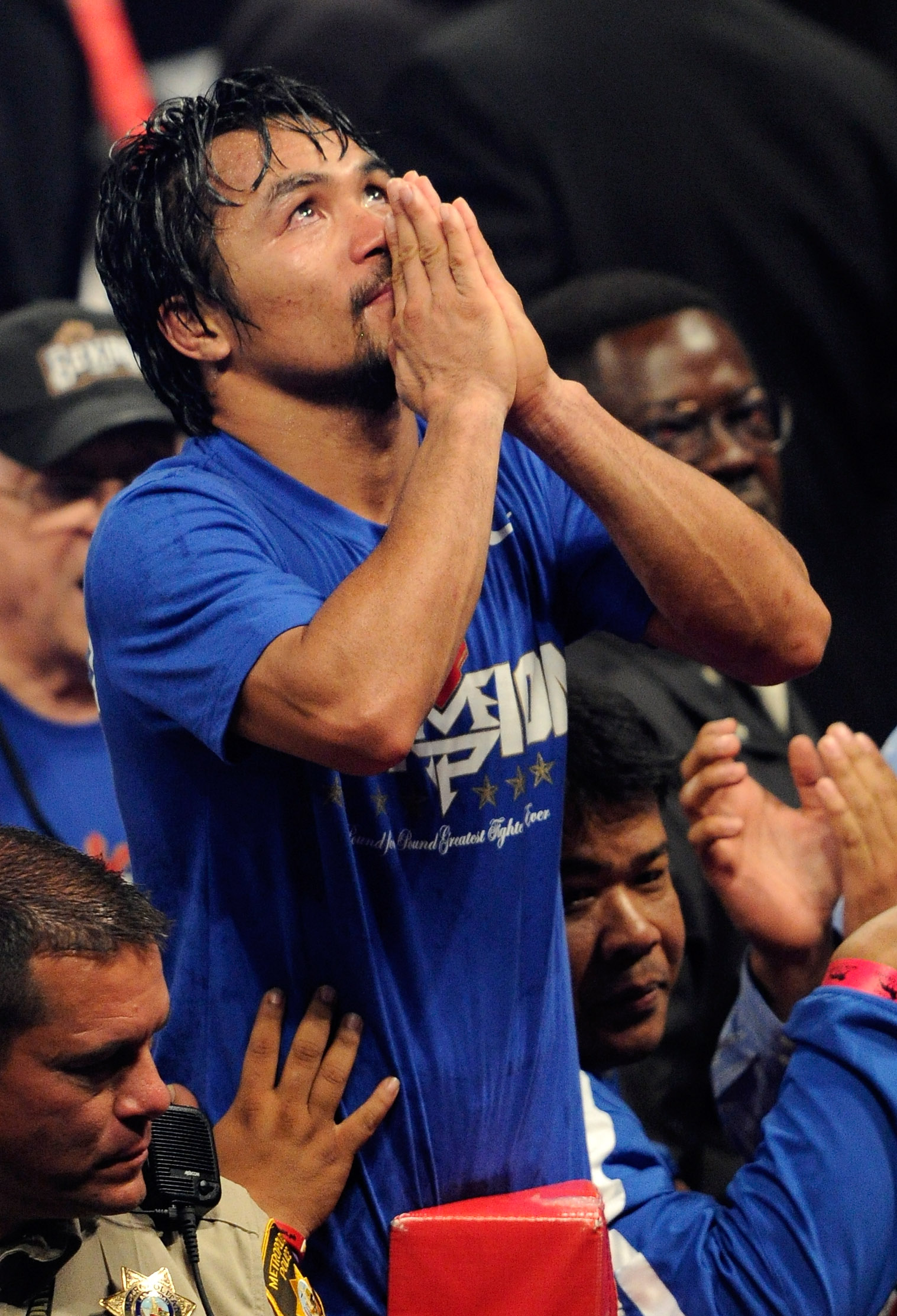 LAS VEGAS, NV - MAY 07:  Manny Pacquiao of the Philippines celebrates after his unanimous decision victory against Shane Mosley in the WBO welterweight title fight at MGM Grand Garden Arena on May 7, 2011 in Las Vegas, Nevada.  (Photo by Ethan Miller/Gett