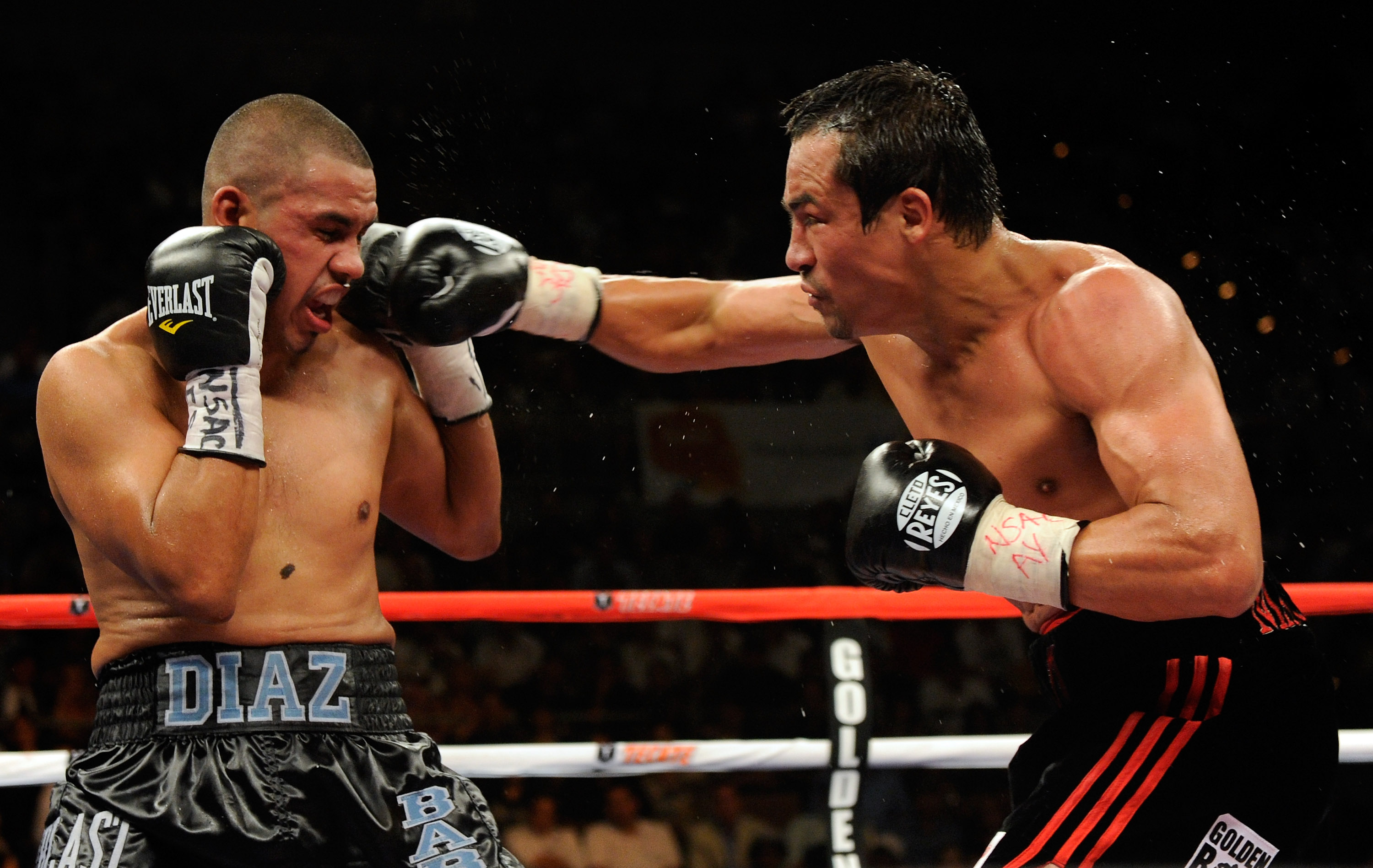 LAS VEGAS - JULY 31:  WBA/WBO lightweight champion Juan Manuel Marquez (R) hits Juan Diaz in the eighth round of their bout at the Mandalay Bay Events Center July 31, 2010 in Las Vegas, Nevada. Marquez retained his WBA and WBO lightweight championship bel