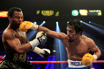 LAS VEGAS, NV - MAY 07:  (R-L) Manny Pacquiao of the Philippines connects with a right to the head of Shane Mosley in the WBO welterweight title fight at MGM Grand Garden Arena on May 7, 2011 in Las Vegas, Nevada.  (Photo by Chris Trotman/Getty Images)