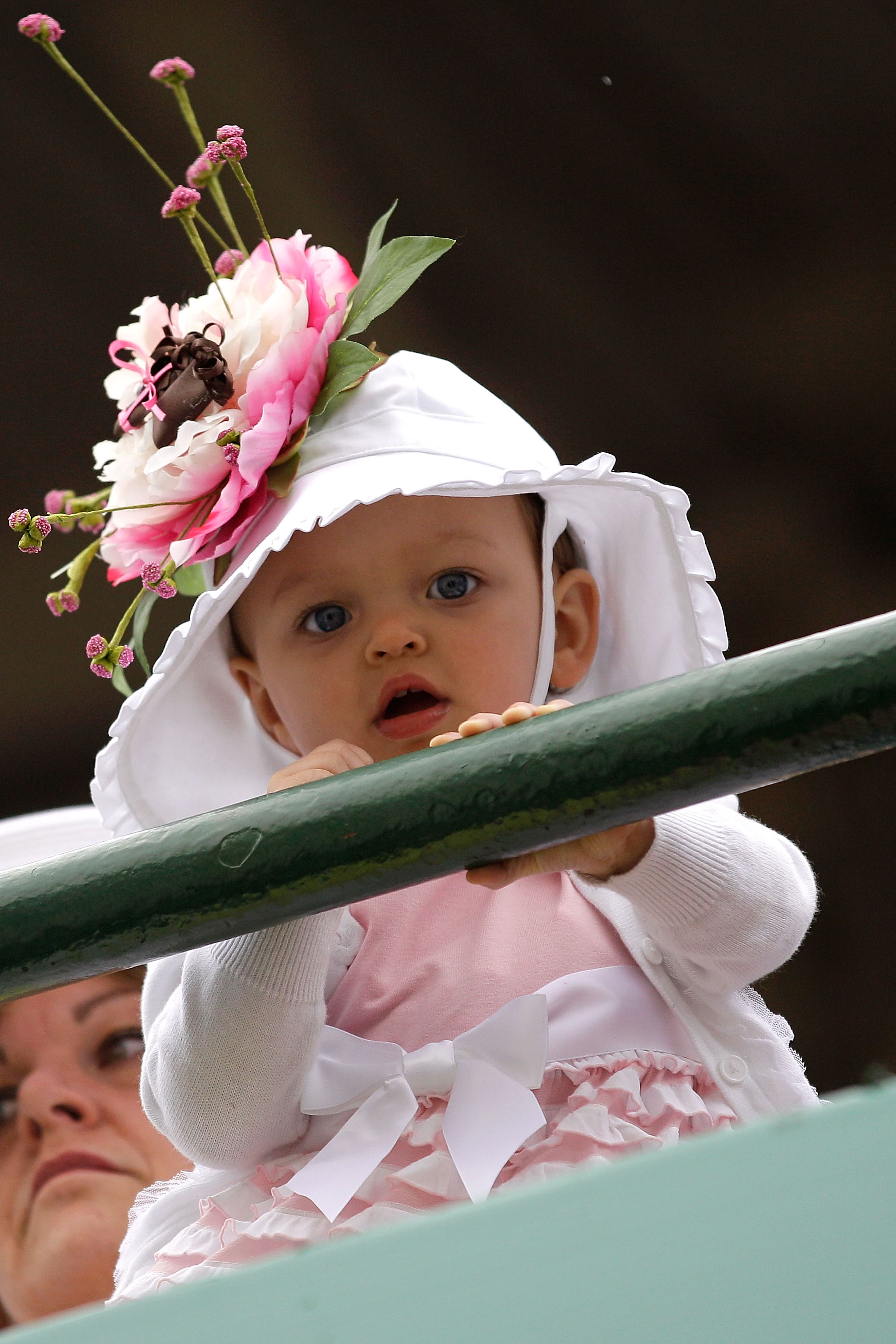 LOUISVILLE, KY - MAY 07:  A baby looks on from the grandstands during the 137th Kentucky Derby at Churchill Downs on May 7, 2011 in Louisville, Kentucky.  (Photo by Rob Carr/Getty Images)
