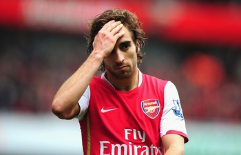 LONDON - APRIL 05:  Mathieu Flamini of Arsenal is dejected after the Barclays Premier League match between Arsenal and Liverpool held at the Emirates Stadium on April 5, 2008 in London, England.  (Photo by Shaun Botterill/Getty Images)