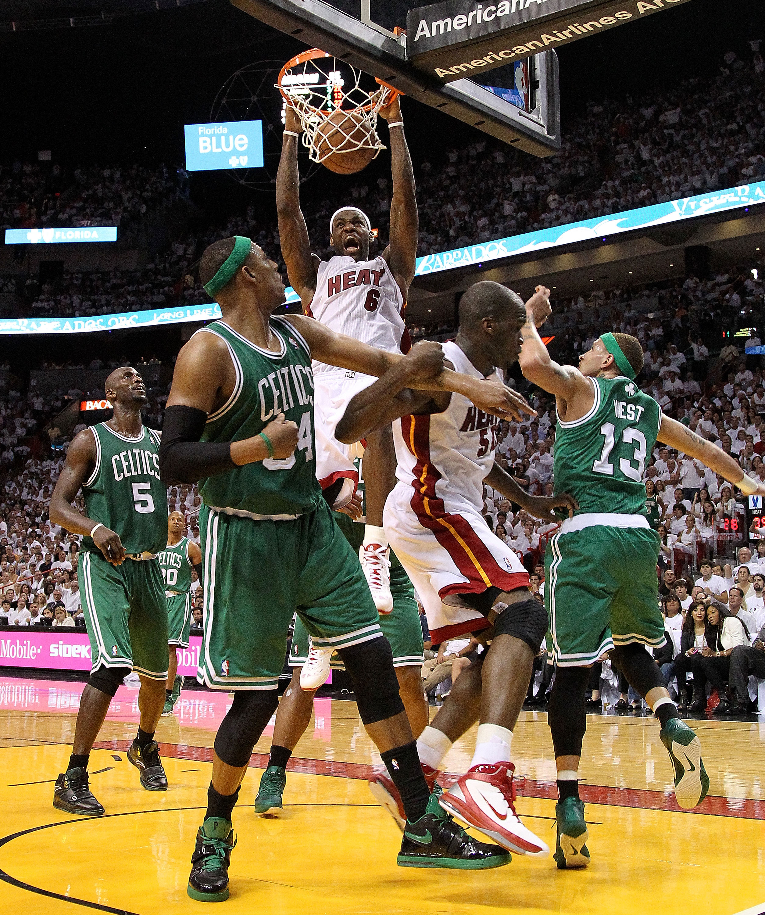 MIAMI, FL - MAY 03:  LeBron James #6 of the Miami Heat dunks over Paul Pierce #34 and Delonte West #13 of  the Boston Celtics during Game Two of the Eastern Conference Semifinals of the 2011 NBA Playoffs at American Airlines Arena on May 3, 2011 in Miami,