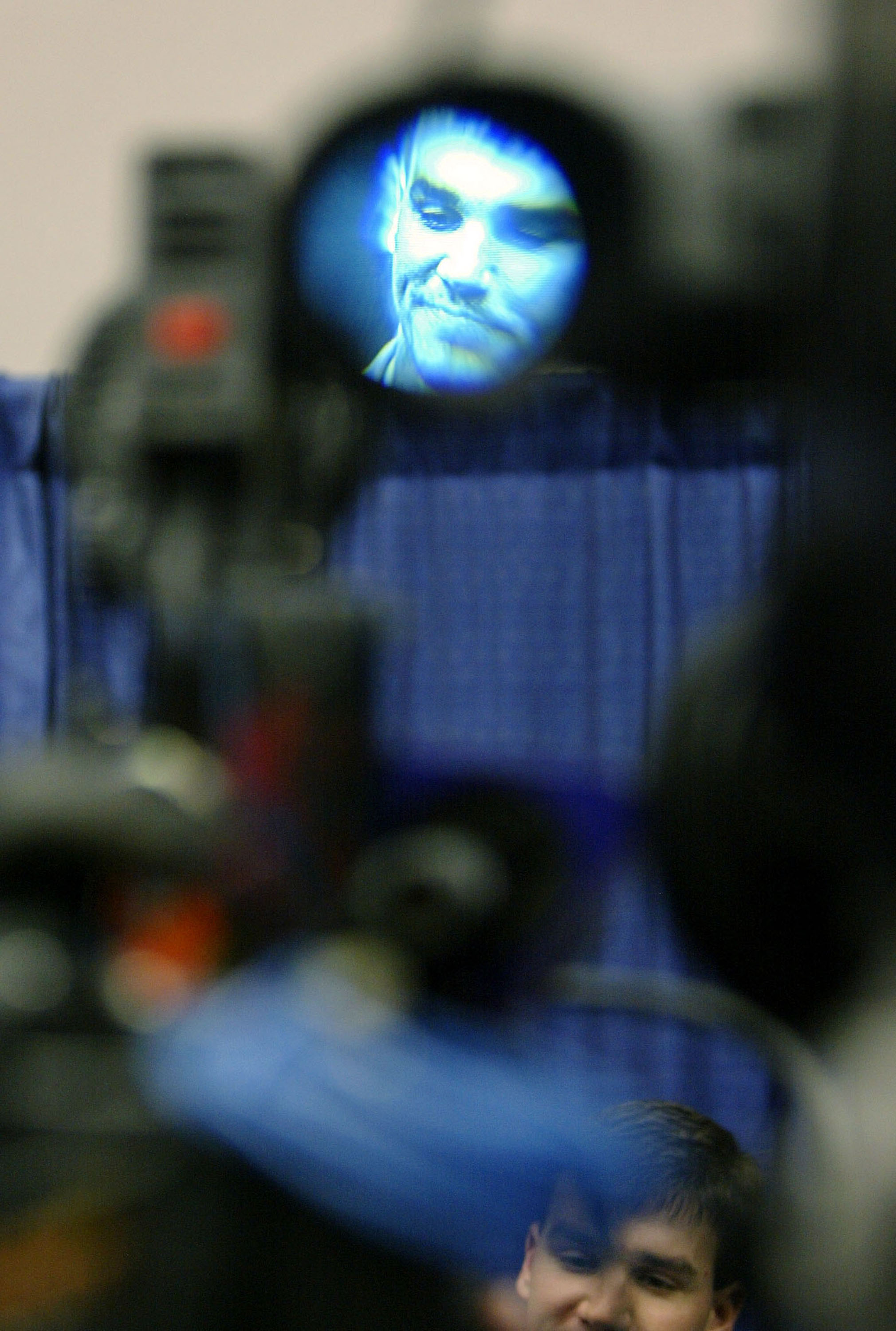 HOUSTON - JANUARY 26:  Quarterback Jake Delhomme of the Carolina Panthers is seen through the view finder of a television camera as he answers questions from the media as a television camera rolls before Super Bowl XXXVIII against the New England Patriots