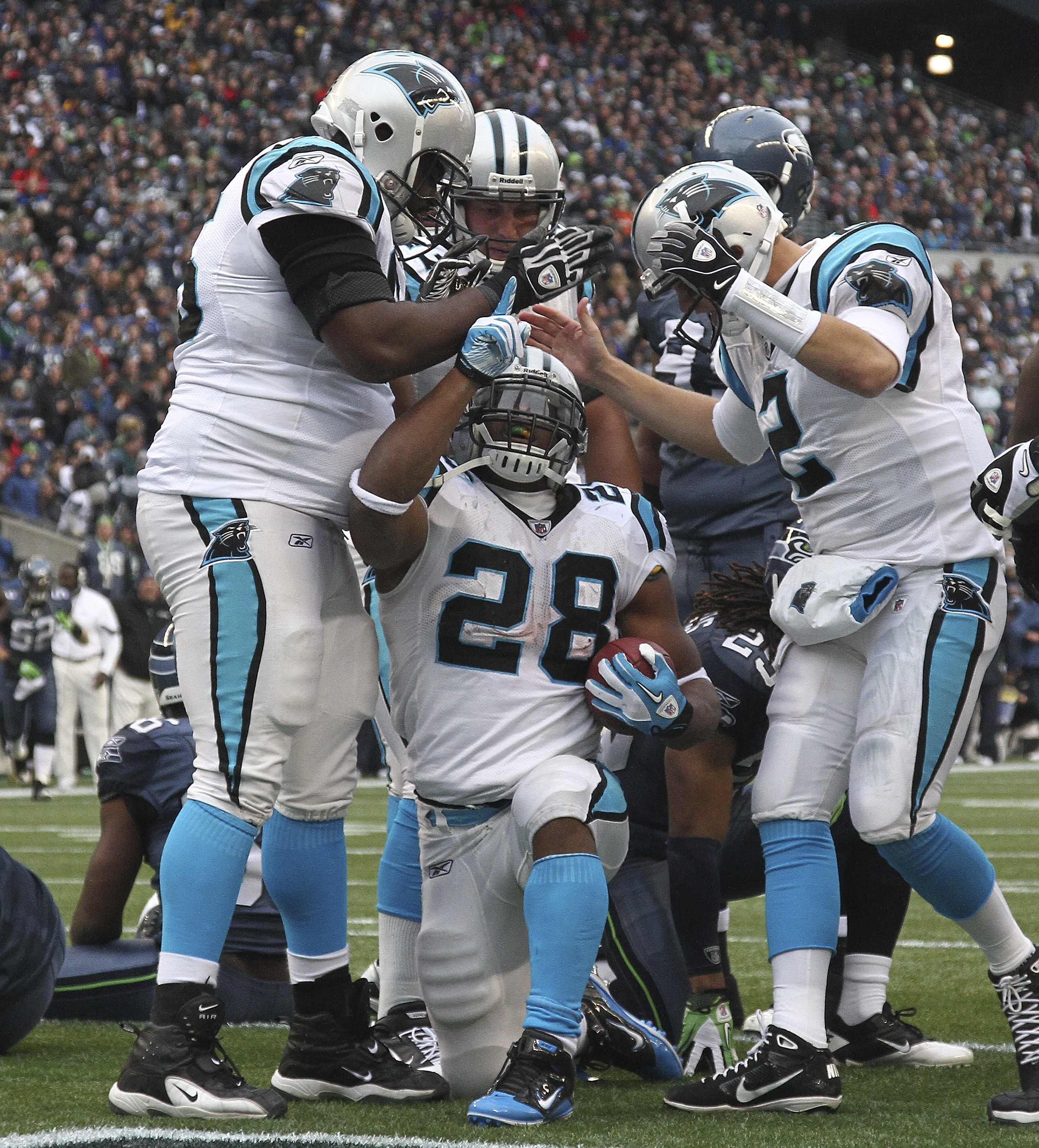 SEATTLE, WA - DECEMBER 05:  Running back Jonathan Stewart #28 of the Carolina Panthers celebrates with teammates after scoring a touchdown in the second quarter against the Seattle Seahawks at Qwest Field on December 5, 2010 in Seattle, Washington. The Se