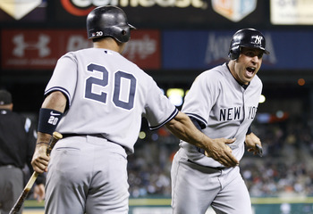 DETROIT, MI - MAY 02:  Mark Teixeira #25 of the New York Yankees celebrates with Jorge Posada #20 after scoring off of a Nick Swisher #33 ninth inning single while playing the Detroit Tigers at Comerica Park on May 2, 2011 in Detroit, Michigan.  (Photo by