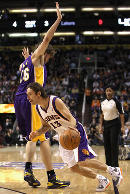 PHOENIX - JANUARY 05: Steve Nash #13 of the Phoenix Suns drives the ball past Pau Gasol #16 of the Los Angeles Lakers during the NBA game at US Airways Center on January 5, 2011 in Phoenix, Arizona. NOTE TO USER: User expressly acknowledges and agrees tha