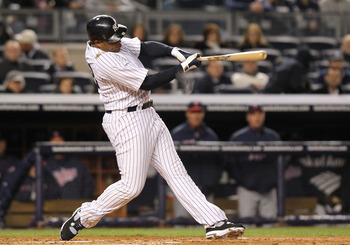 NEW YORK, NY - APRIL 05:  Andruw Jones #18 of the New York Yankees hits a solo homerun against the Minnesota Twins at Yankee Stadium on April 5, 2011 in the Bronx borough of New York City.  (Photo by Nick Laham/Getty Images)