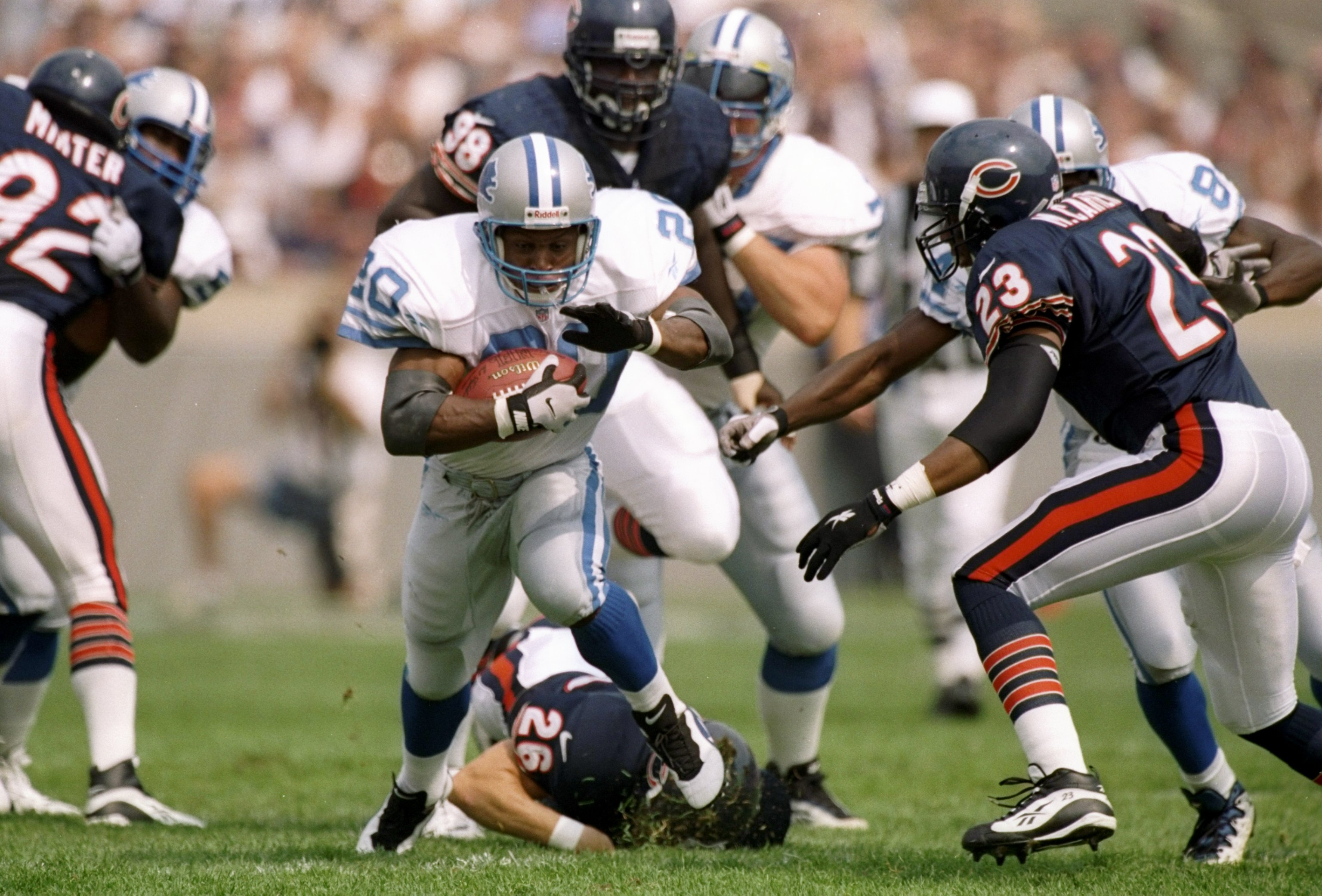 14 Sep 1997:  Running back Barry Sanders of the Detroit Lions moves the ball during a game against the Chicago Bears at Soldier Field in Chicago, Illinois.  The Lions won the game, 32-7. Mandatory Credit: Jonathan Daniel  /Allsport