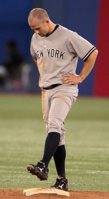 TORONTO, ON - APRIL 19:  Brett Gardner #11 of the New York Yankees waits at second base after being called out to end the inning during their game against the Toronto Blue Jays at Rogers Centre on April 19, 2011 in Toronto, Canada.  (Photo by Scott Haller