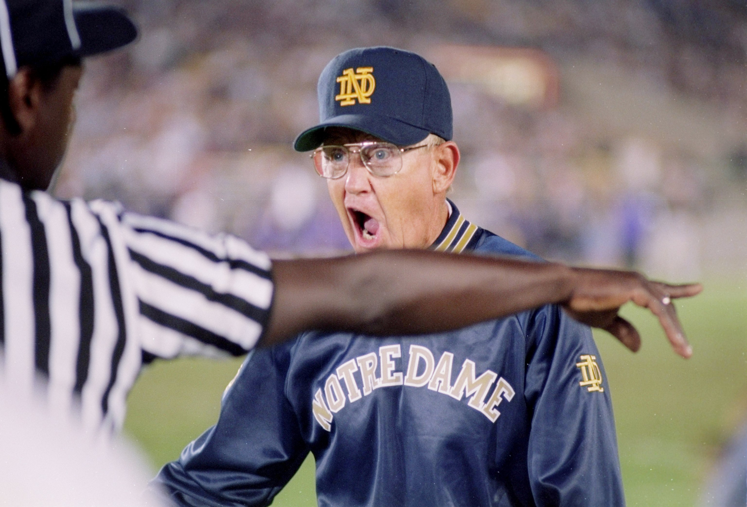 3 Sep 1994:  Coach Lou Holtz of the Notre Dame Fighting Irish argues with the official during a game against the Northwestern Wildcats.  Notre Dame won the game 42-15. Mandatory Credit: Jonathan Daniel  /Allsport