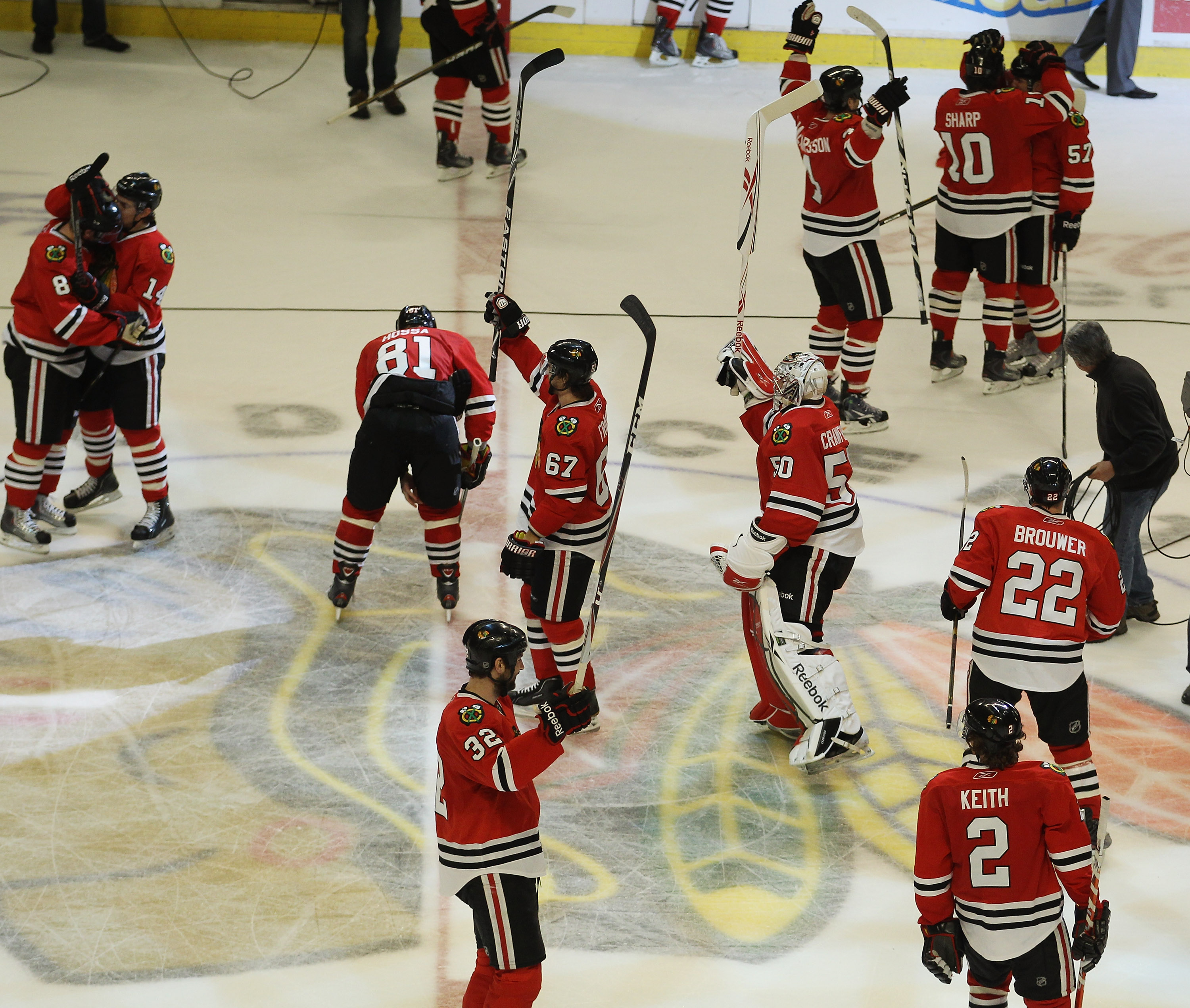 CHICAGO, IL - APRIL 24: Members of the Chicago Blackhawks salute the crowd and celebrate a win over the Vancouver Canucks in Game Six of the Western Conference Quarterfinals during the 2011 NHL Stanley Cup Playoffs at the United Center on April 24, 2011 i