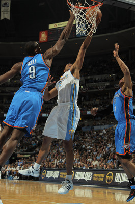 DENVER, CO - APRIL 25:  Arron Afflalo #6 of the Denver Nuggets lays up a shot between Serge Ibaka #9 of the Oklahoma City Thunder and Russell Westbrook #0 of the Oklahoma City Thunder in Game Four of the Western Conference Quarterfinals in the 2011 NBA Pl