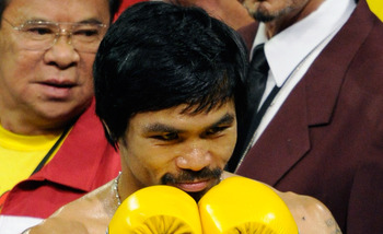 LAS VEGAS, NV - MAY 07:  Boxer Manny Pacquiao acknowledges fans before his WBO welterweight title fight against Shane Mosley at the MGM Grand Garden Arena May 7, 2011 in Las Vegas, Nevada. Pacquiao, who retained his title by unanimous decision, wore yello