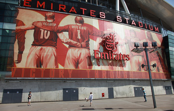LONDON, ENGLAND - APRIL 11:  Boys play football in front of Arsenal Football Club's Emirates Stadium on April 11, 2011 in London, England. American businessman Stan Kroenke's company 'Kroenke Sports Enterprises' has increased its shareholding in Arsenal t