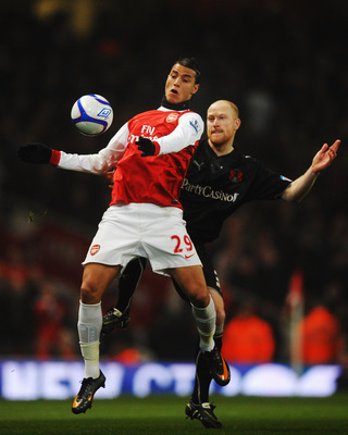 LONDON, UNITED KINGDOM - MARCH 02:  Marouane Chamakh (L) of Arsenal holds off the challenge of Andrew Whing (R) of Leyton Orient during the FA Cup sponsored by E.ON 5th Round Replay match between between Arsenal and Leyton Orient at the Emirates Stadium o
