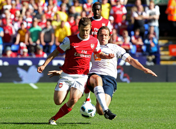 BOLTON, ENGLAND - APRIL 24:  Kevin Davies of Bolton Wanderers challenges Jack Wilshere of Arsenal during the Barclays Premier League match between Bolton Wanderers and Arsenal at the Reebok Stadium on April 24, 2011 in Bolton, England.  (Photo by Michael