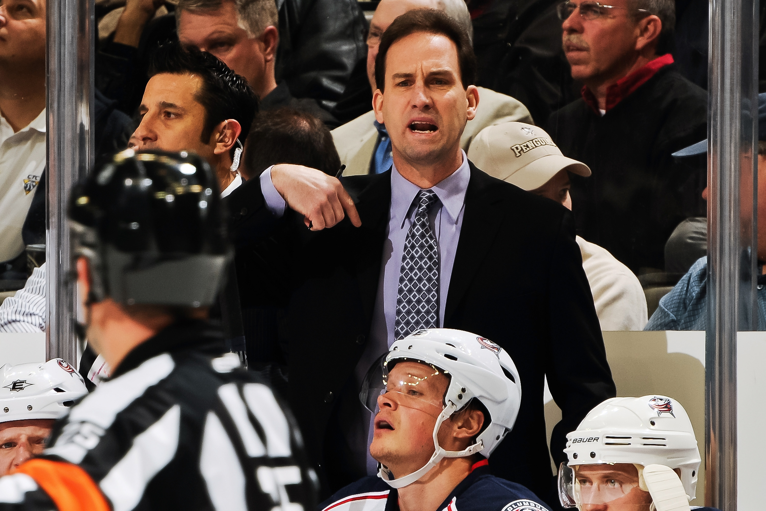 PITTSBURGH, PA - FEBRUARY 8:  Head Coach Scott Arniel of the Columbus Blue Jackets talks with a referee during a game against the Pittsburgh Penguins on February 8, 2011 at CONSOL Energy Center in Pittsburgh, Pennsylvania.  (Photo by Jamie Sabau/Getty Ima