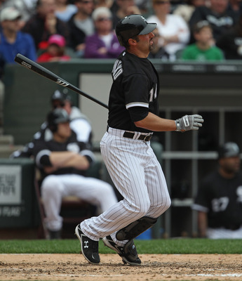 CHICAGO, IL - MAY 01: Paul Konerko #14 of the Chicago White Sox hits the ball against the Baltimore Orioles at U.S. Cellular Field on May 1, 2011 in Chicago, Illinois. The Orioles defeated the White Sox 6-4. (Photo by Jonathan Daniel/Getty Images)