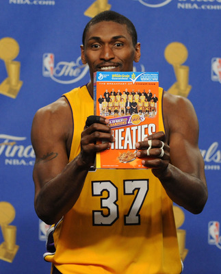 LOS ANGELES, CA - JUNE 17:  Ron Artest #37 of the Los Angeles Lakers holds up a Wheaties box during the post game news conference as he celebrates after the Lakers defeated the Boston Celtics 83-79 in Game Seven of the 2010 NBA Finals at Staples Center on