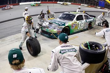 DARLINGTON, SC - MAY 07:  Kyle Busch pits the #18 Wrigley's Doublemint Toyota during the NASCAR Sprint Cup Series SHOWTIME Southern 500 at Darlington Raceway on May 7, 2011 in Darlington, South Carolina.  (Photo by Chris Graythen/Getty Images)