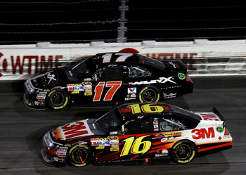 DARLINGTON, SC - MAY 07: Greg Biffle, driver of the #16 3M Ford races with Matt Kenseth, driver of the #17 Wiley X Eyewear Ford, during the NASCAR Sprint Cup Series SHOWTIME Southern 500 at Darlington Raceway on May 7, 2011 in Darlington, South Carolina.