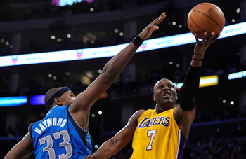 LOS ANGELES, CA - APRIL 12:  Lamar Odom #7 of the Los Angeles Lakers drives against the San Antonio Spurs during the game at Staples Center on April 12, 2011 in Los Angeles, California.  NOTE TO USER: User expressly acknowledges and agrees that, by downlo