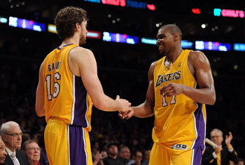 LOS ANGELES, CA - APRIL 20:  Pau Gasol #16 and Andrew Bynum #17 of the Los Angeles Lakers celebrate as Bynum comes to the bench while taking on the New Orleans Hornets in Game Two of the Western Conference Quarterfinals in the 2011 NBA Playoffs on April 2