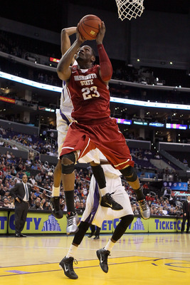 LOS ANGELES, CA - MARCH 10:  DeAngelo Casto #23 of the Washington State Cougars goes up for a shot in the lane against the Washington Huskies in the quarterfinals of the 2011 Pacific Life Pac-10 Men's Basketball Tournament at Staples Center on March 10, 2