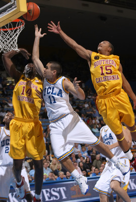 WESTWOOD, CA - FEBRUARY 4:  Spencer Soo #11 of the UCLA Bruins shoots between Mamadou Diarra #14 and Percy Miller #15 of the USC Trojans on February 4, 2009 at Pauley Pavillion in Westwood, California.   UCLA won 76-60.   (Photo by Stephen Dunn/Getty Imag