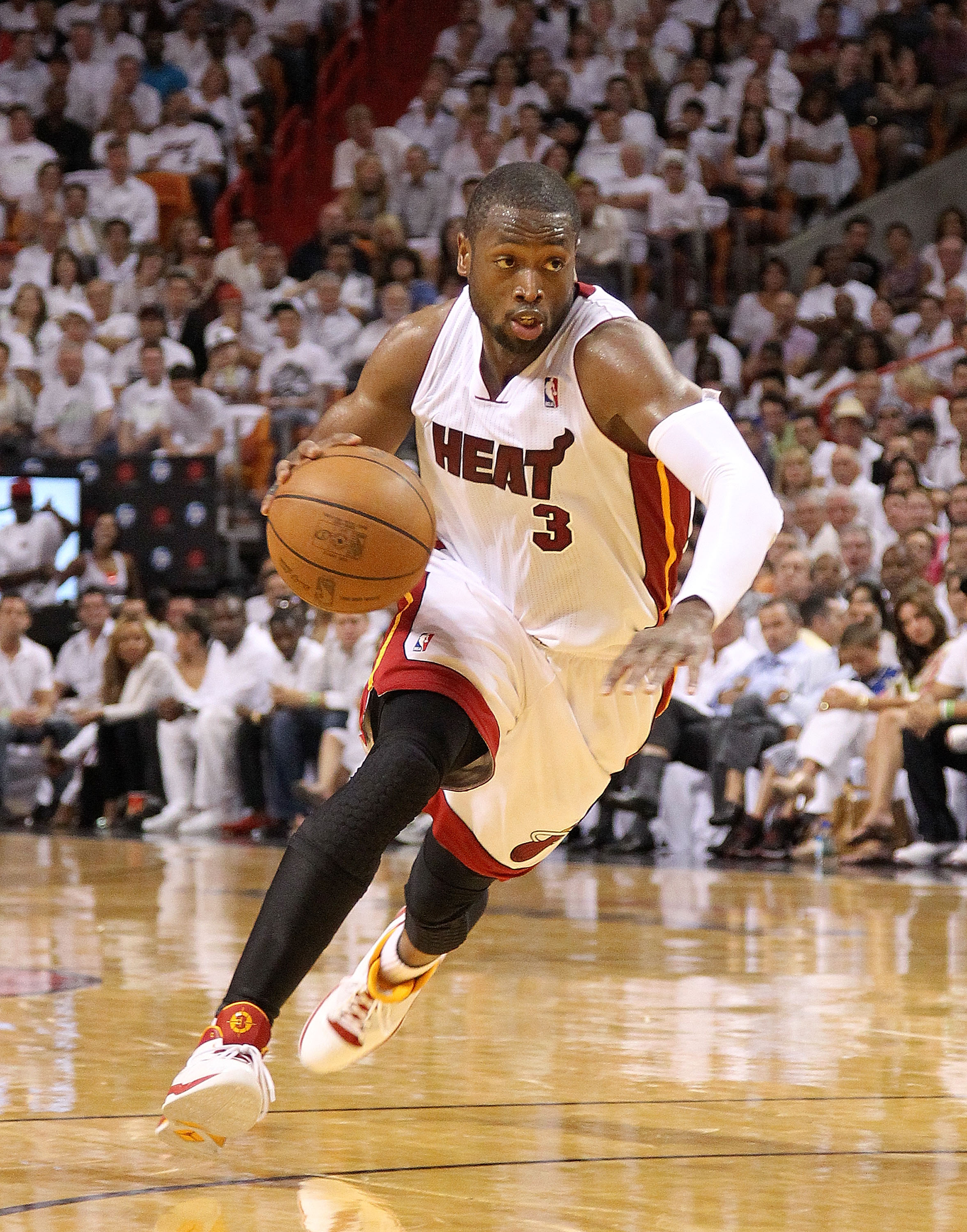 MIAMI, FL - APRIL 27:  Dwyane Wade #3 of the Miami Heat drives to the lane during game five of the Eastern Conference Quarterfinals in the 2011 NBA Playoffs against the Philadelphia 76ers at American Airlines Arena on April 27, 2011 in Miami, Florida. NOT
