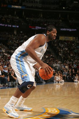 DENVER - DECEMBER 22:  Nene #31 of the Denver Nuggets controls the ball against the Sacramento Kings at the Pepsi Center on December 22, 2006 in Denver, Colorado. The Kings won 101-96. NOTE TO USER: User expressly acknowledges and agrees that, by download