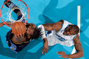 NEW ORLEANS - DECEMBER 18:  Nene #31 of the Denver Nuggets makes a shot over David West #30 of the New Orleans Hornets at New Orleans Arena on December 18, 2009 in New Orleans, Louisiana.  The Hornets defeated the Nuggets 98-92.  NOTE TO USER: User expres