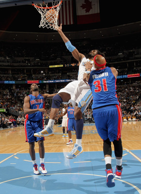 DENVER, CO - MARCH 12:  Nene #31 of the Denver Nuggets is fouled by Charlie Villanueva #31 of the Detroit Pistons as he goes to the basket at the Pepsi Center on March 12, 2011 in Denver, Colorado. NOTE TO USER: User expressly acknowledges and agrees that
