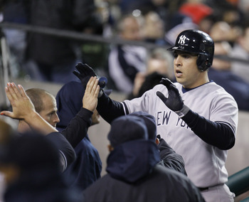 DETROIT, MI - MAY 03:  Mark Teixeira #25 of the New York Yankees celebrates a eighth inning home run while returning to the dugout while playing the Detroit Tigers at Comerica Park on May 3, 2011 in Detroit, Michigan. Detroit won the game 4-2. (Photo by G