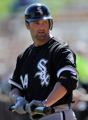 PHOENIX, AZ - FEBRUARY 28:  Paul Konerko #14 of the Chicago White Sox warms up against the Los Angeles Dodgers during spring training at Camelback Ranch on February 28, 2011 in Phoenix, Arizona.  (Photo by Harry How/Getty Images)