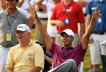 PONTE VEDRA BEACH, FL - MAY 11:  Tiger Woods (R) and Mark O'Meara (L) react to a shot by caddie Steve Williams (not pictured) for the 'Caddie Challenge' on the 17th hole during a practice round prior to the start of THE PLAYERS Championship held at THE PL