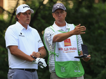 CHARLOTTE, NC - MAY 07:  Phil Mickelson and his caddie Jim Mackay during the third round of the Wells Fargo Championship at Quail Hollow Club on May 7, 2011 in Charlotte, North Carolina.  (Photo by Streeter Lecka/Getty Images)