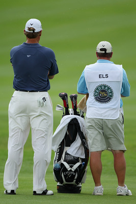 SUN CITY, SOUTH AFRICA - DECEMBER 02:  Ernie Els of South Africa stand with his caddie Ricci Roberts during the first round of the 2010 Nedbank Golf Challenge at the Gary Player Country Club Course  on December 2, 2010 in Sun City, South Africa.  (Photo b
