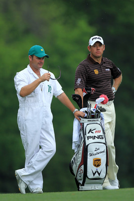 AUGUSTA, GA - APRIL 08:  Lee Westwood of England waits with his caddie Billy Foster on the fifth hole during the second round of the 2011 Masters Tournament at Augusta National Golf Club on April 8, 2011 in Augusta, Georgia.  (Photo by David Cannon/Getty