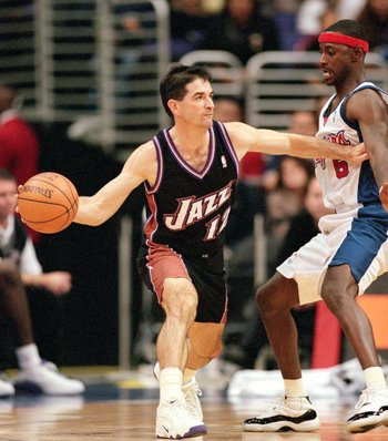 8 Nov 2000:  John Stockton #12 of the Utah Jazz passes the ball away from Jeff McInnis #5 of the Los Angeles Clippers during the game at the Staples Center in Los Angeles, California.  The Jazz defeated the Clippers 93-87. NOTE TO USER: It is expressly un